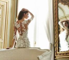Vestuvinių suknelių tendencija: kristalais puoštas permatomas tiulis.